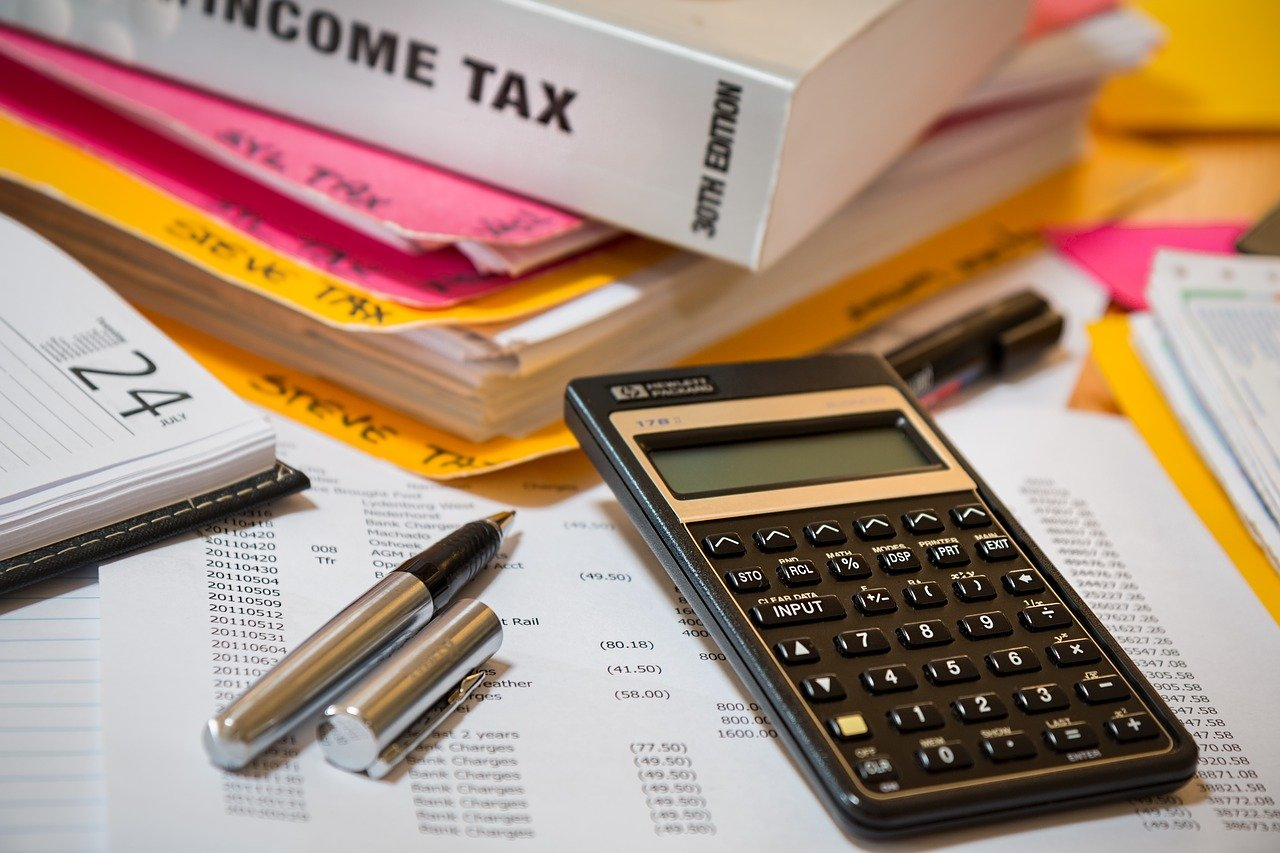 Business tax planning with calculator on desk